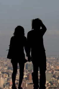 Couple looking over city