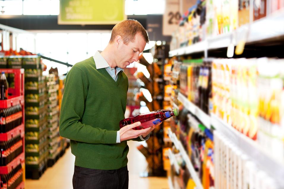 man-at-store-checking-price