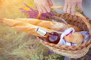 basket with pastries and wine for a budget picnic date