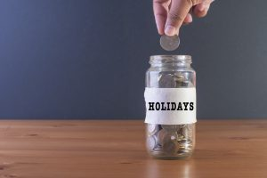 "savings jar labeled ""holidays"""