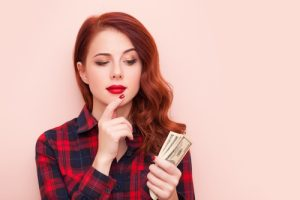 young woman considering how to wisely conserve her cash