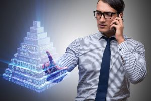 businessman talking on phone with suggested pyramid scheme hologram