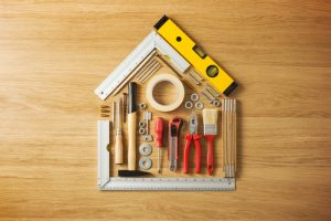 tools assembled on a flat background to resemble a house