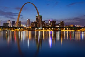 St Louis skyline reflected off the water at night.