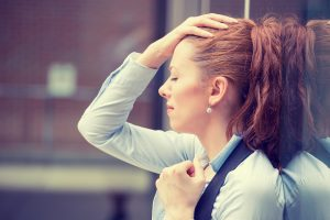 young professional woman experiencing stress over finances