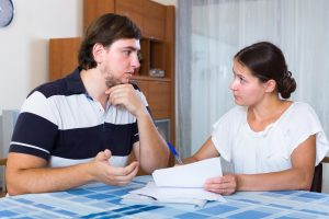 Spouses discussing credit debt and bills