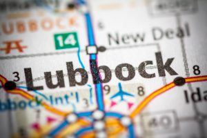 "Close up of the word ""Lubbock"" on a map of the state of Texas."