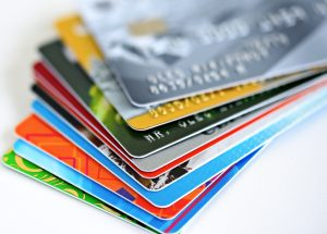 Display of multiple credit cards fanned out on a flat surface.