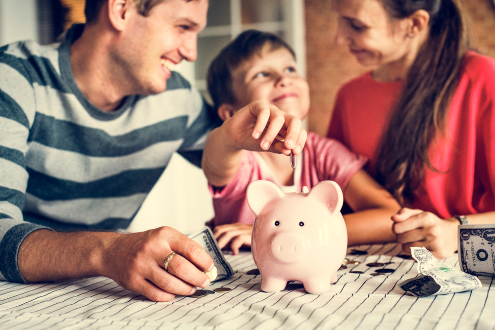 parents with son discussing money