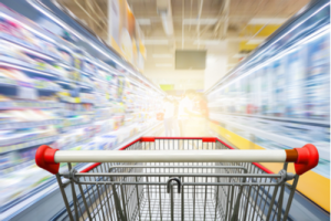 Concept of shopping cart moving at high speed with store aisles blurring to its sides