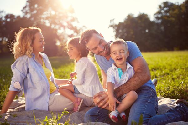 young family enjoying frugal picnic